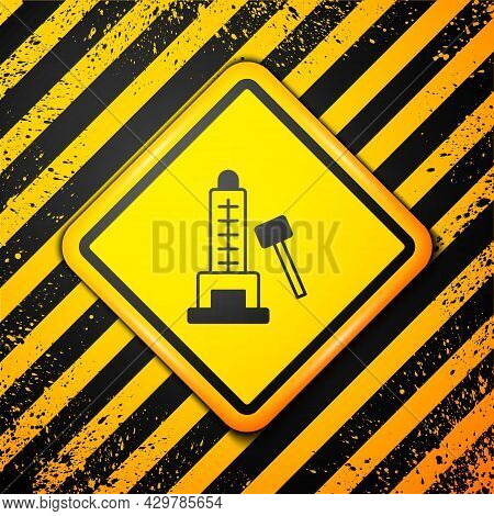 Black High Striker Attraction With Big Hammer Icon Isolated On Yellow Background. Attraction For Mea