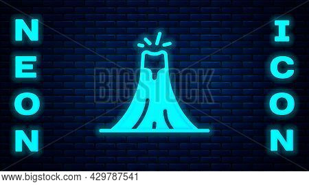 Glowing Neon Volcano Eruption With Lava Icon Isolated On Brick Wall Background. Vector