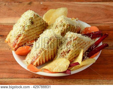 Veg Cheese Grilled Sandwich Served With Ketchup, Isolated Over A Rustic Wooden Background, Selective