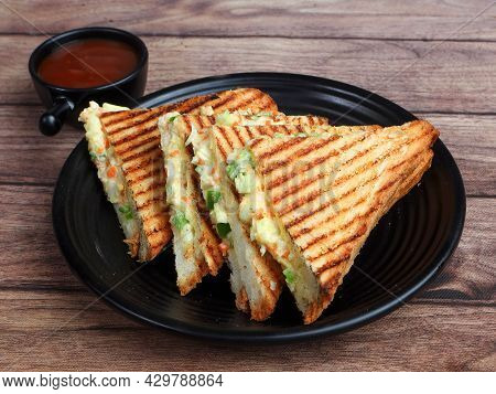 Veg Grilled Sandwich Served With Ketchup, Isolated Over A Rustic Wooden Background, Selective Focus