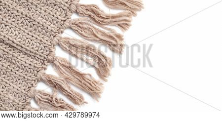 Beige Woolen Knitted Scarf With Tassels On White Background, Empty Place On Right.