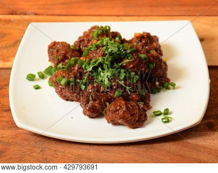 Veg Manchurian, Popular Indo-chinese Food Made Of Cauliflower Florets And Other Vegetable, Served In