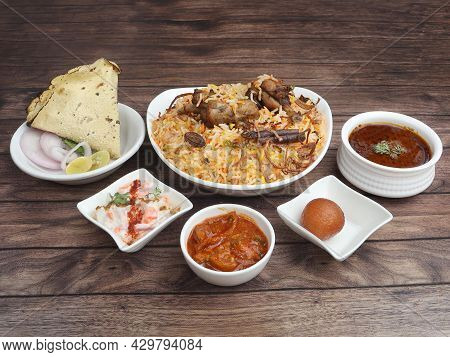 Chicken Biryani Thali - Basmati Rice Cooked With Chicken Meat And Spices And Served With Mirchi Ka S