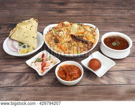 Veg Biryani Thali - Basmati Rice Cooked With Veggies And Spices And Served With Mirchi Ka Salan,rait