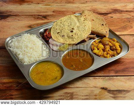 Veg Thali From An Indian Cuisine, Food Platter Consists Variety Of Veggies, Lentils,rice,roti, Papad