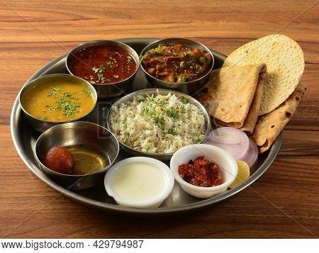 Maharashtraian Veg Thali From An Indian Cuisine, Food Platter Consists Variety Of Veggies, Lentils,