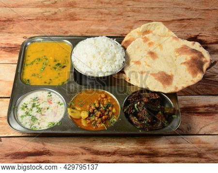 Veg Thali From An Indian Cuisine, Food Platter Consists Variety Of Veggies, Lentils,chole, Steamed R