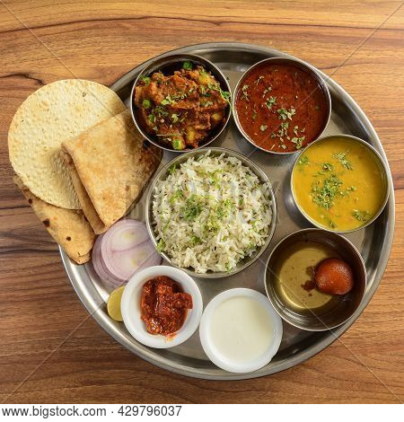 Veg Thali From An Indian Cuisine, Food Platter Consists Variety Of Veggies,paneer Dish, Lentils, Jee