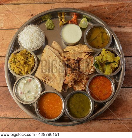 Veg Thali From An Indian Cuisine, Food Platter Consists Variety Of Veggies,paneer Dish, Lentils, Ste