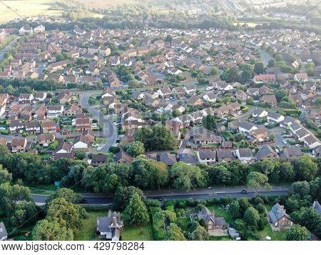An Aerial View Of A Typical Suburban Development Of Modern Detached Housing