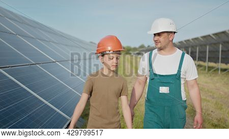 Engineer Father Is Explaining To His Little Son An Operation And Performance Of Photovoltaic Solar P