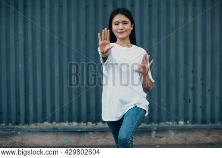 Asian Young Woman Doing Qigong Exercise Summer Outdoor Wall