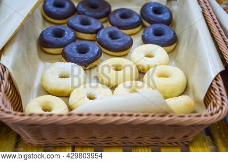 Sweet donuts in a paper donut  dessert snack food, Different type of donuts set