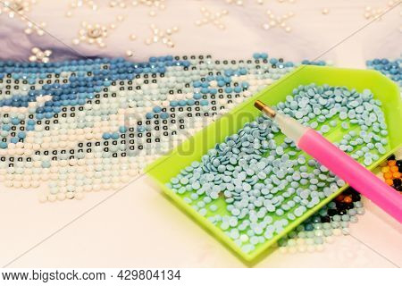 Diamond Painting Embroidery Craft. Acrylic Rhinestones And Pen Tool. Closeup, Selective Focus