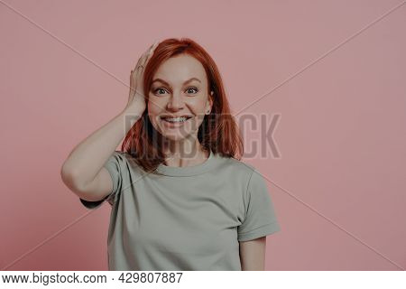 Portrait Of Excited Amazed Redhead Ginger Girl Touching Head With Surprised Facial Expression, Stand
