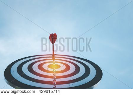Business Marketing As Concept. Red Dart Arrow Hitting In The Target Center Of Dartboard Target Hit I