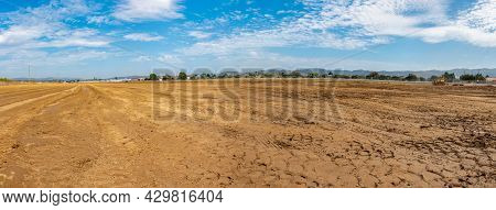 Panoramic View Across The Graded Farmland Dirt Full Of Tire Tracks And Potential To Build.