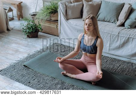 Wellbeing And Mindfulness Concept. Young Peaceful Happy Woman With Closed Eyes Practicing Meditation