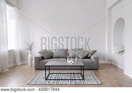 Room Interior, Modern Home Design With Furniture. Grey Sofa At White Apartment, Living Room In Simpl