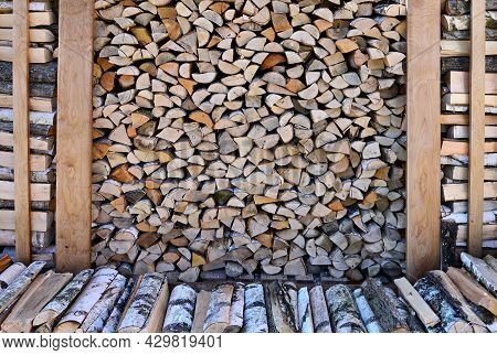 Preparation Of Firewood For Winter. A Beautiful Woodpile Made Of Birch Wood. Stacks Of Firewood. Rur