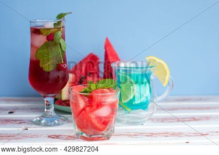 Three Types Of Different Fruit And Berry Drinks. Cherry, Watermelon Red And Blue With Lemon Alcoholi