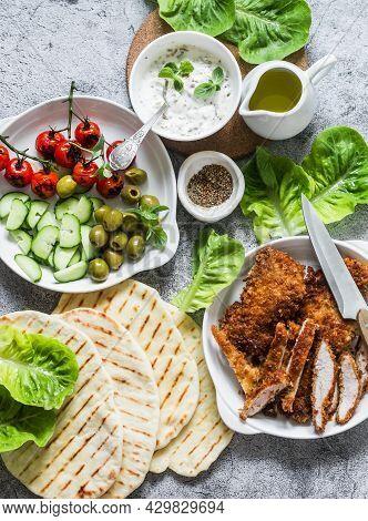 Ingredients For Cooking Greek Gyros - Chicken Schnitzel, Lettuce, Tortillas, Greek Yogurt Sauce, Tom