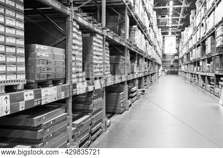 A Black And White Defocused Image Of A Store Warehouse, Or Factory Warehouse. Industrial Theme.
