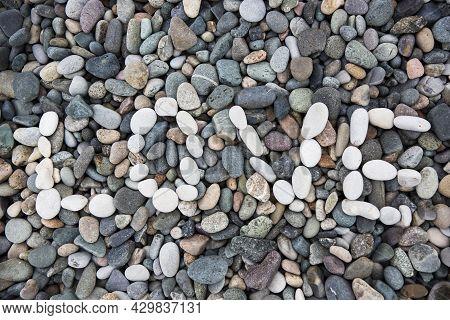 Sea Gray Stones. Background From Sea. Wet Gray Stones For Design. White Pebble Inscription Love.