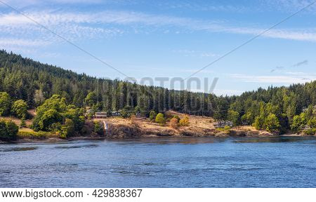 View Of A Cosy Homes On The Rocky Coast During A Sunny Summer Day. Taken On Galiano Island Near Vanc