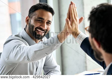 Indian Happy Smiling Multiracial Professional Ceo Businessman Giving Highfive To Business Partner Af