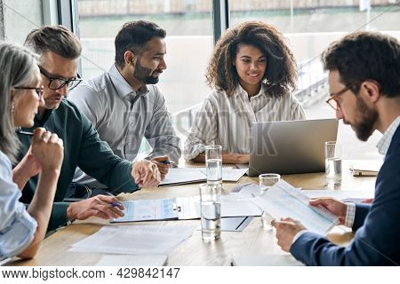 Diverse Executive Businesspeople Discuss Corporation Financial Plan At Boardroom Meeting Table. Mult