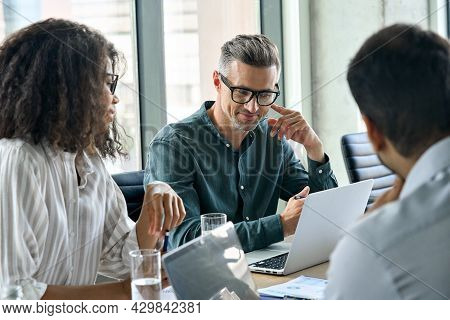 Diverse International Executive Business People Working On Project At Boardroom Meeting Table Using