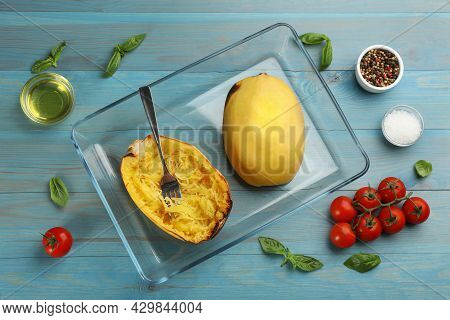 Cooked Spaghetti Squashes In Baking Dish And Ingredients On Turquoise Wooden Table, Flat Lay
