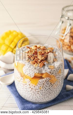 Delicious Chia Pudding With Granola And Mango On White Table