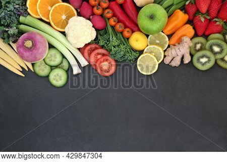 Plant based vegan health food for fitness. Healthy sustainable foods concept high in nutritional value with antioxidants, anthocyanins, minerals, vitamins, dietary fibre, smart carbs. On slate border.