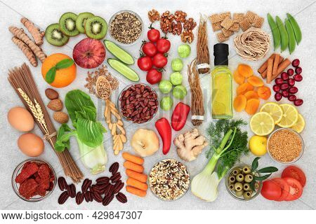 Worlds healthiest food collection for health and fitness high in protein, omega 3, antioxidants, fibre, anthocyanins, smart carbs, minerals, vitamins, lycopene. Natural health care concept.