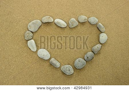 Heart Of Basalt Pebbles On Golden Beach