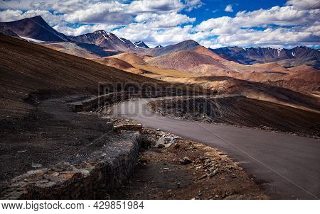 Road To The Mountain With Out Of Focus Foreground, Leh, Ladakh, India