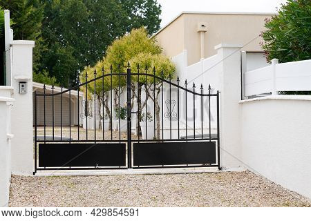 Black Steel Gate House Portal Of Old Traditional European House