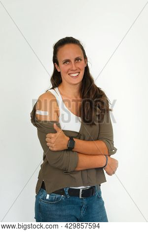 Coronavirus Vaccination Advertisement. Happy Vaccinated Woman Showing Arm With Plaster Bandage After