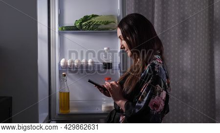 Silhouette Of Young Woman In Stylish Gown Making List Of Food Products To Buy Looking Inside Open Re