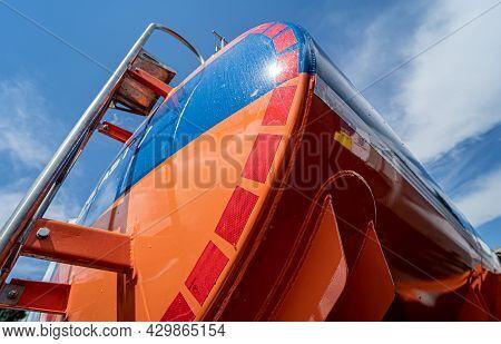 Big Fuel Tanker Truck On The Blue Sky Background