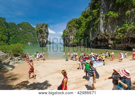 JAMES BOND ISLAND, THAILAND - NOV 8, 2012: Unidentified tourists visiting biggest tourist attraction on Phang Nga Bay, Nov. 8, 2012. This place is known as James Bond Island after the movie from 1974.