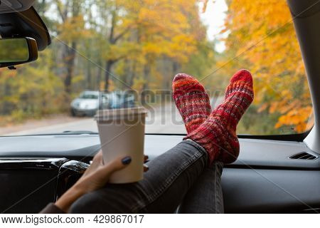Unrecognizable Female In Grey Jeans And Red Striped Warm Knitted Socks Stopping For Coffee Break. Se