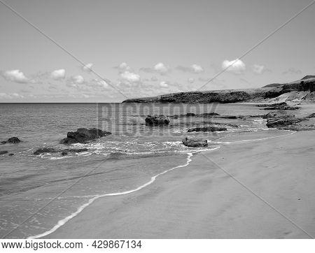 Wild Beach With Sand And Big Rocks, Las Coloradas, Coast Of Jandia, Fuerteventura Island, Spain