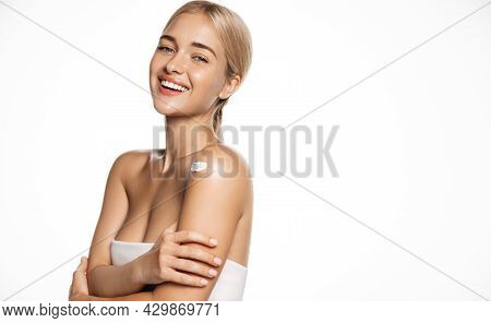Cosmetology And Spa. Healthy Young Blond Woman Wear Towel After Shower, Smiling And Looking Happy, U