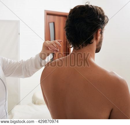 Reflexologists Hand With Acupuncture Needle While Insert Needle Into Special Point On Mans Body Meri