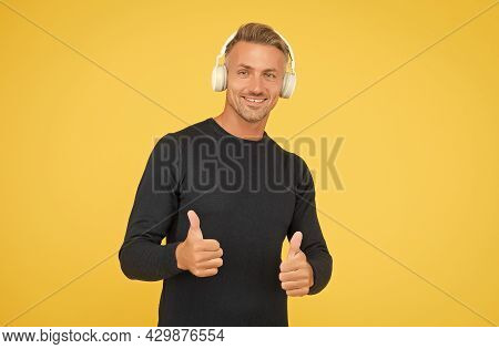 Only The Best. Music And Digital Technology. Ebook And Elearning. Unshaven Guy In Headset Listening