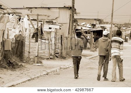 men walk on the street in Khayelitsha township