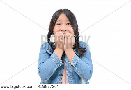 Little Girl Scared ,afraid And Anxious Biting Her Finger Nails, Looking At Camera With Wide Opened E